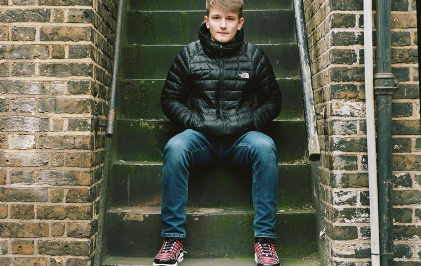 One of supporters, 17-year-old Max, sitting on stairs