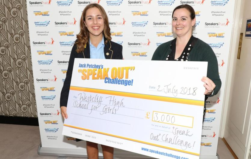 Erin Stoner with Trudy Kilcullen, head of the Jack Petchey Foundation, holding an oversized prop cheque for £3,000 made out to Westcliff High School, labelled 'Speak Out Challenge'.