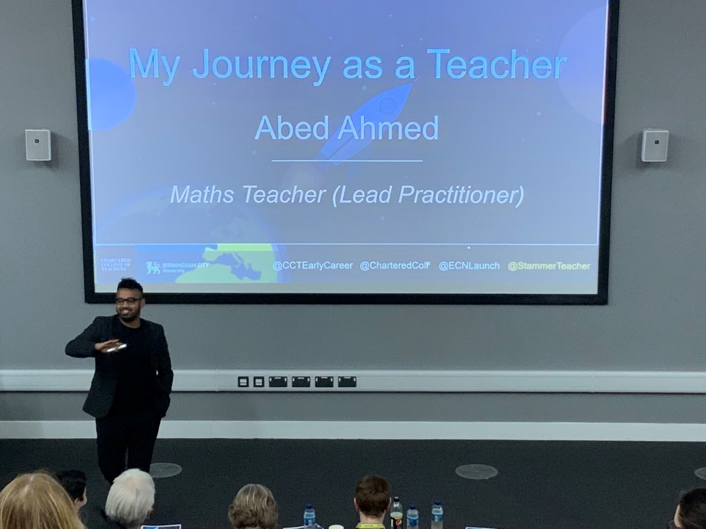 Abed speaking to an audience