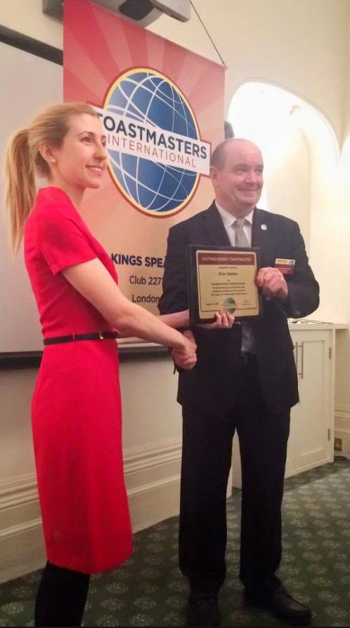 Brian accepting a Toastmasters award